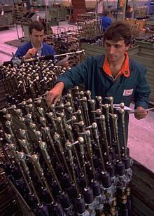 Employees inspect rack and pinion steering gears produced in Eastern Europe for Skoda and Western European automakers.