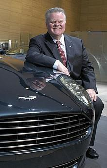 Jim Padilla, President and Chief Operating officer, Ford Motor Company with the Aston Martin Rapide concept vehicle at the 2006 North American International Auto show in Detroit.
