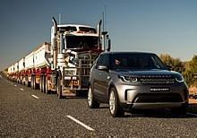 Land Rover Discovery mit Road Train im Schlepp.  Foto: Auto-Medienportal.Net/Land Rover