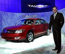 Mark Fields with new 2008 Ford Taurus in Chicago.