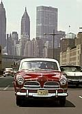 A 1958 Volvo 122 Amazon caught in the middle of Manhattan traffic.