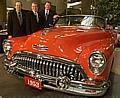 Buick's 100th birthday party in GM World Monday, May 19, 2003 as they pose with a 1953 Buick Roadmaster.